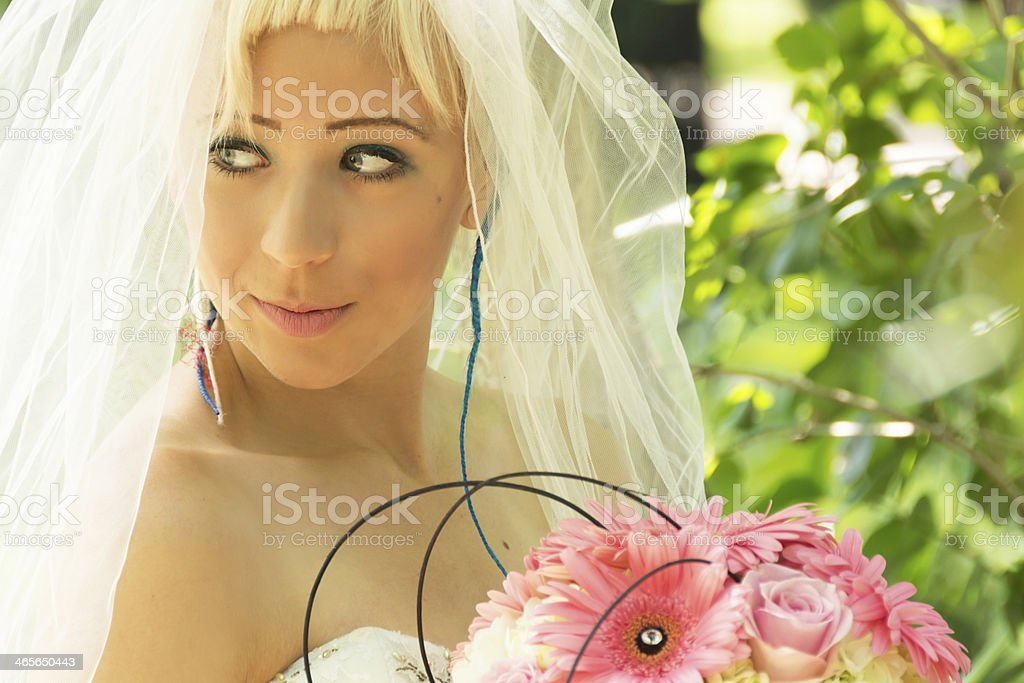 Young blue eyed bride looking away. royalty-free stock photo