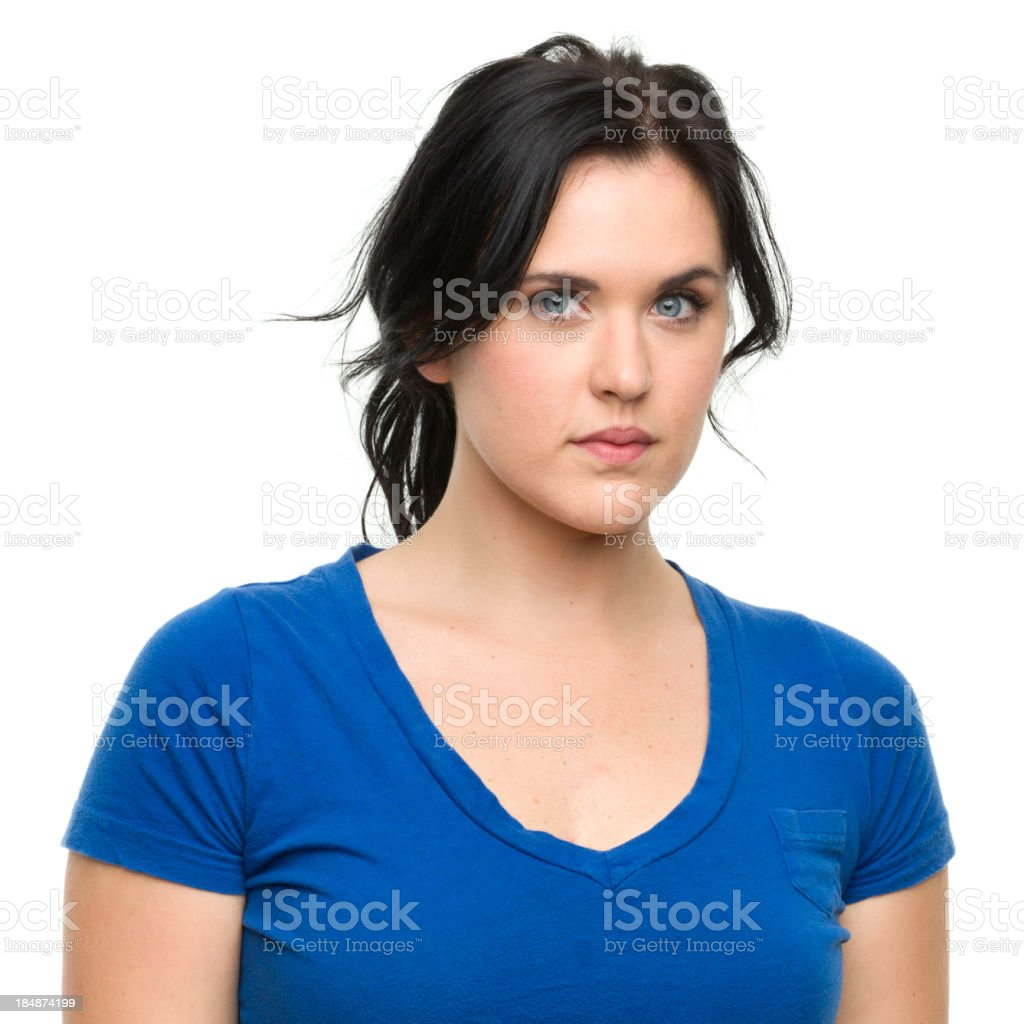 Young blue-eyed woman looking seriously at the camera royalty-free stock photo