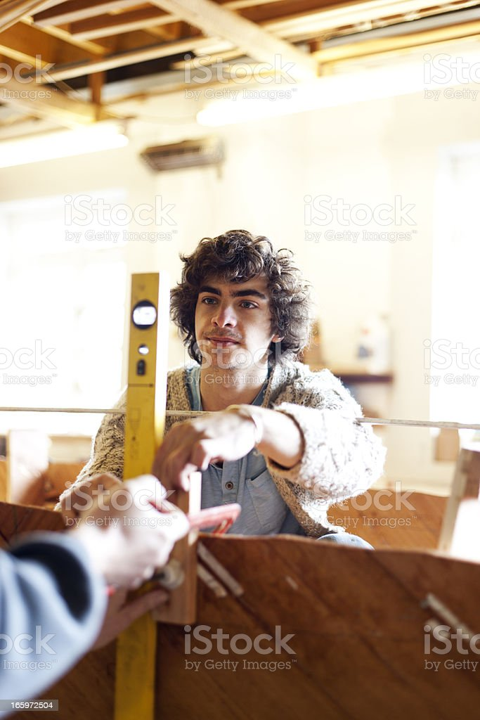 Young boat builders stock photo