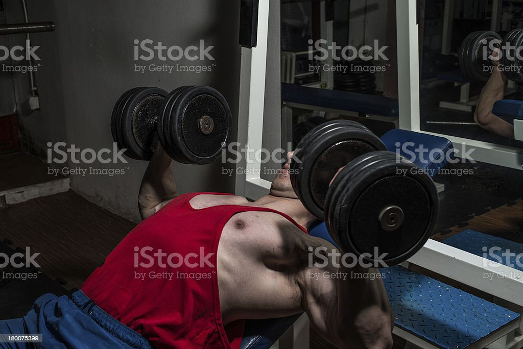 young bodybuilder doing bench press for chest royalty-free stock photo