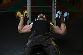 Young Bodybuilder Exercising Chest With Dumbbells