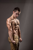 young bodybuilder flexing arm biceps triceps muscle
