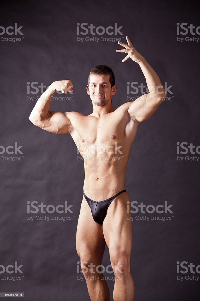 young bodybuilder posing royalty-free stock photo