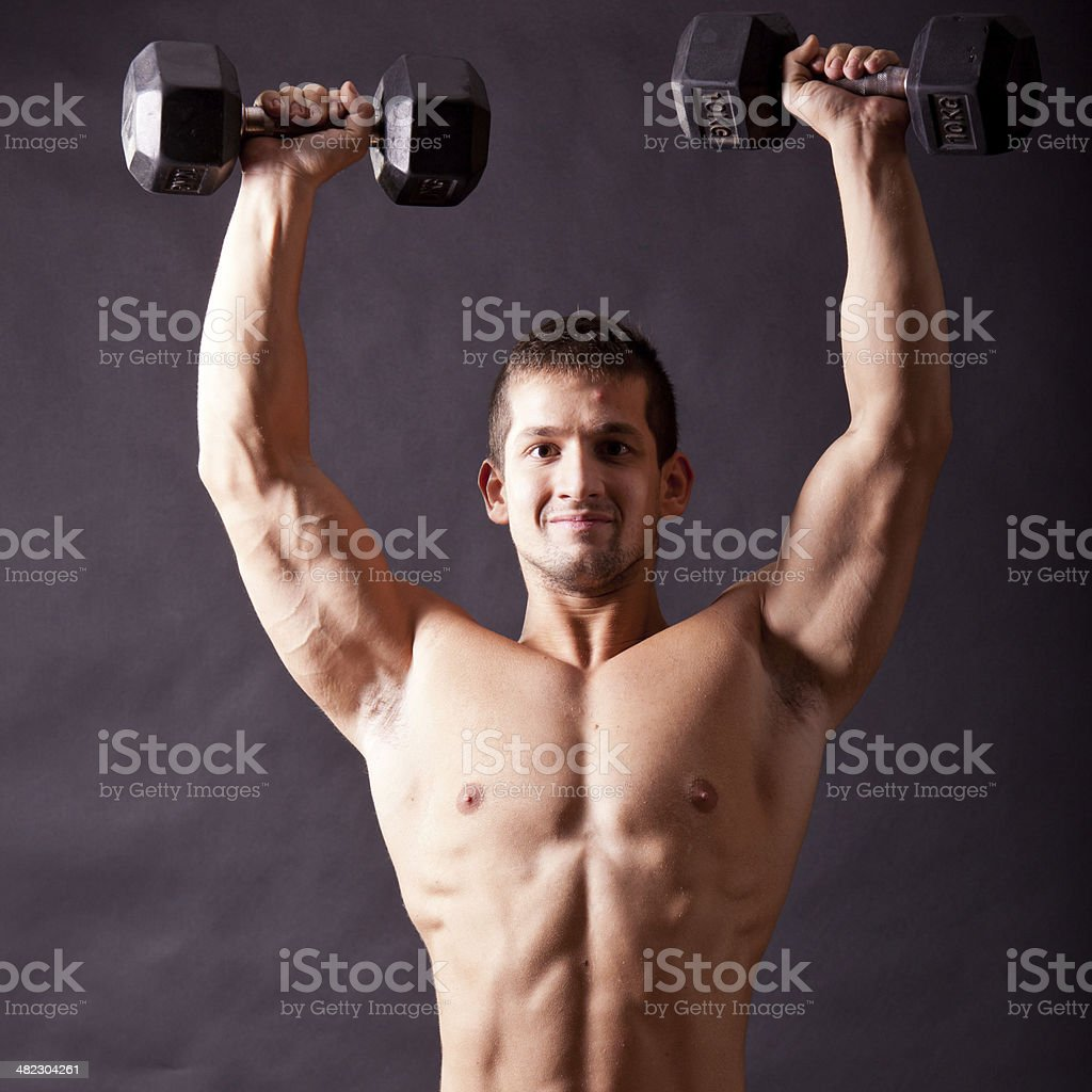 young bodybuilder traininig royalty-free stock photo