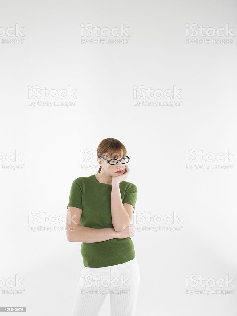 Young Bored Woman In Glasses And Green Tshirt royalty-free stock photo