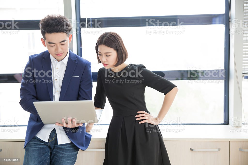 young boss and assistant at work stock photo