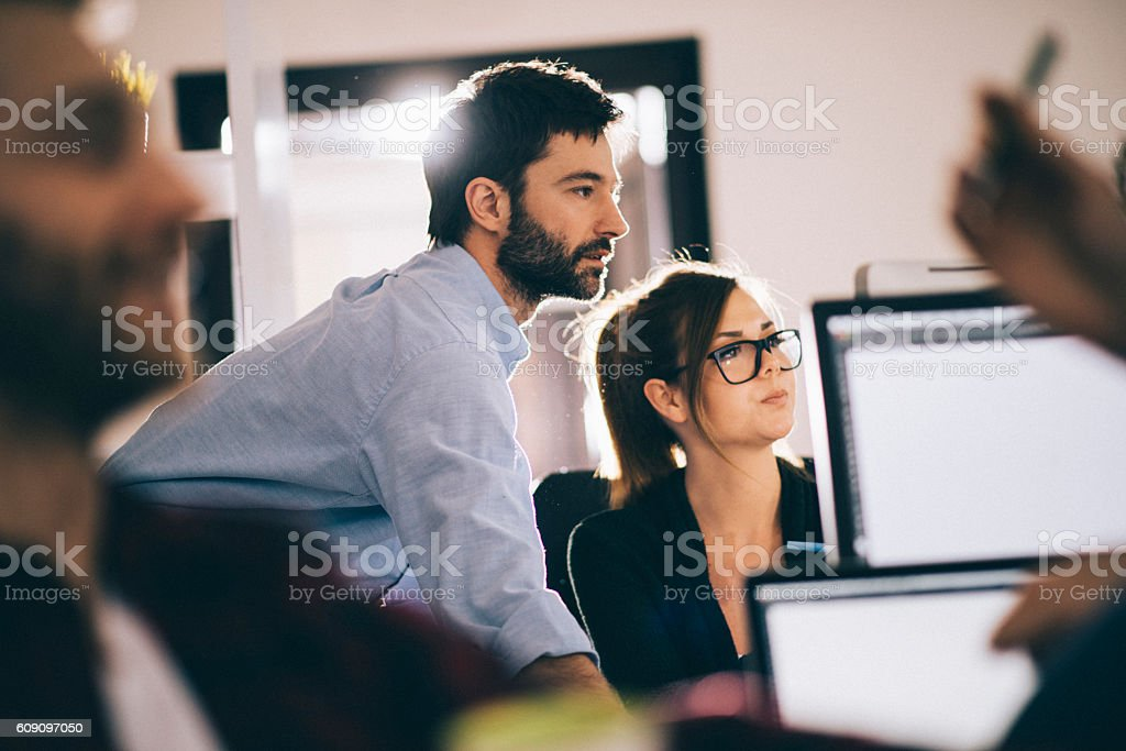 Young boss cheking ongoing projects stock photo