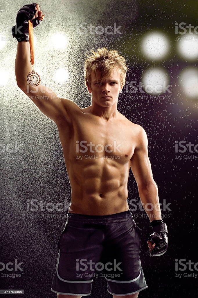 Young Boxer fighter over black background stock photo