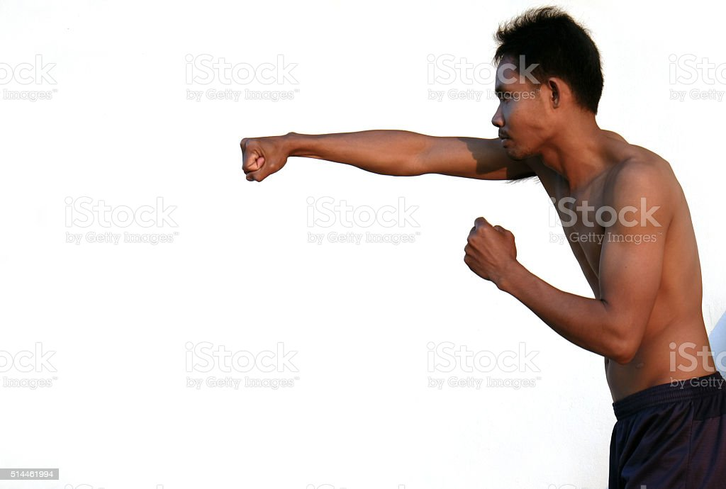 Young Boxer fighter over white background and Shadow stock photo