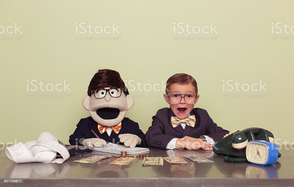 Young Boy Accountant and Puppet Associate stock photo
