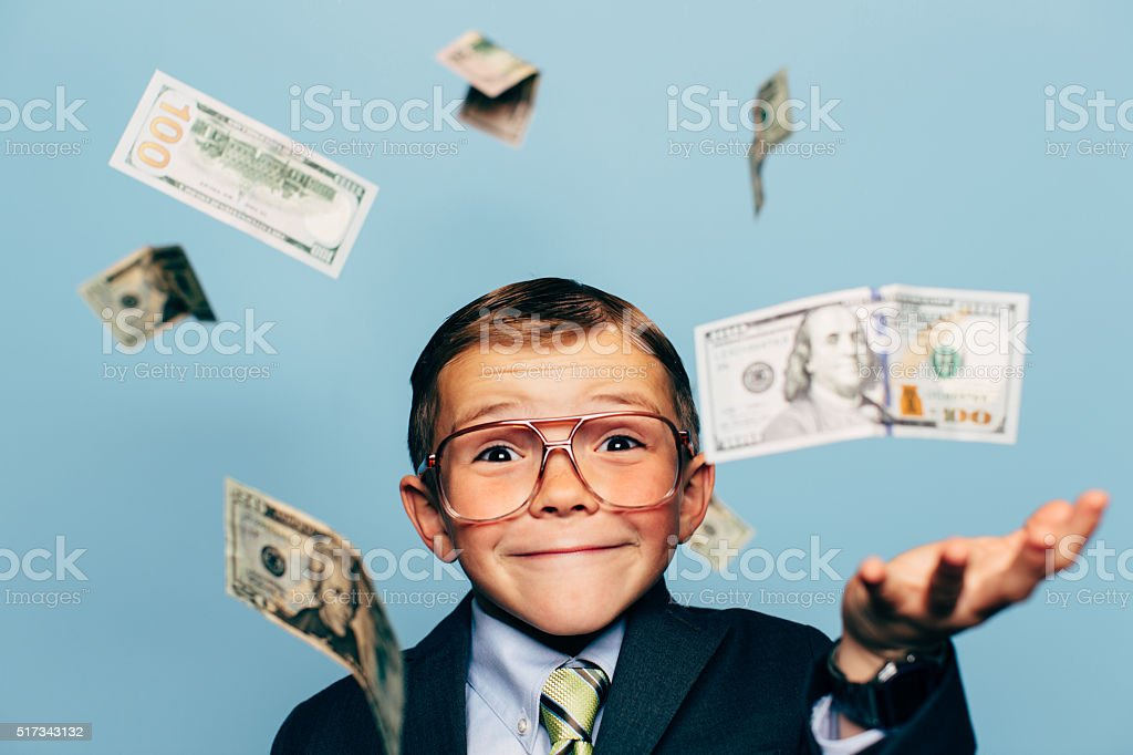 Young Boy Accountant Wearing Glasses with Falling Money stock photo
