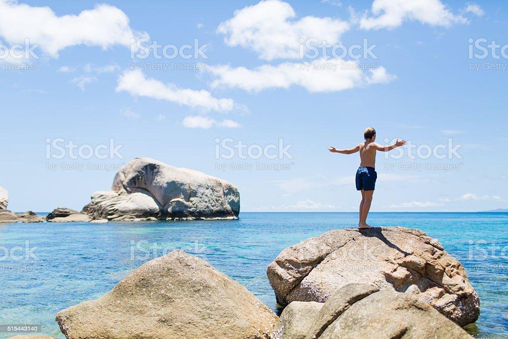 Young boy admiring idilic beech in Thailand. stock photo