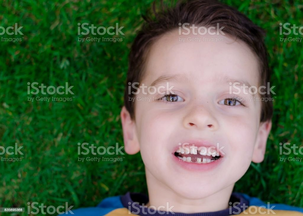 Young boy aged around 5 showing missing tooth stock photo