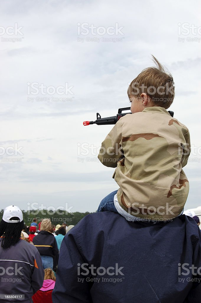 Young Boy Aiming with a Toy Gun royalty-free stock photo