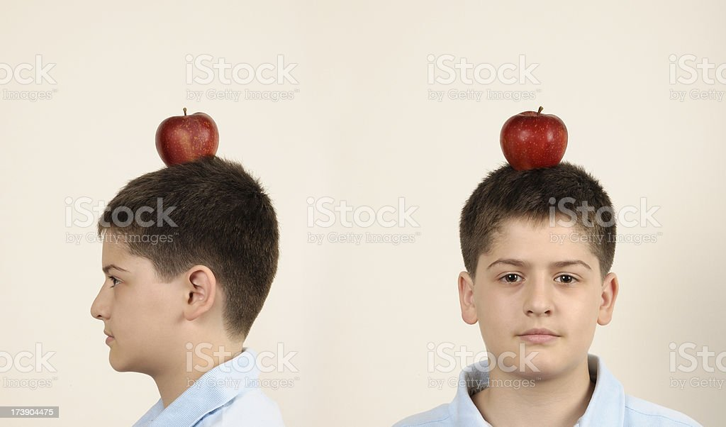 Young boy and apple stock photo