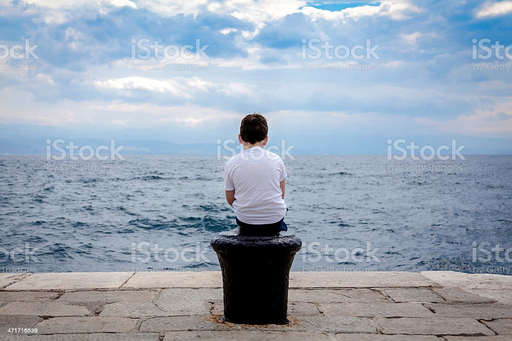 Young boy and big wide sea stock photo