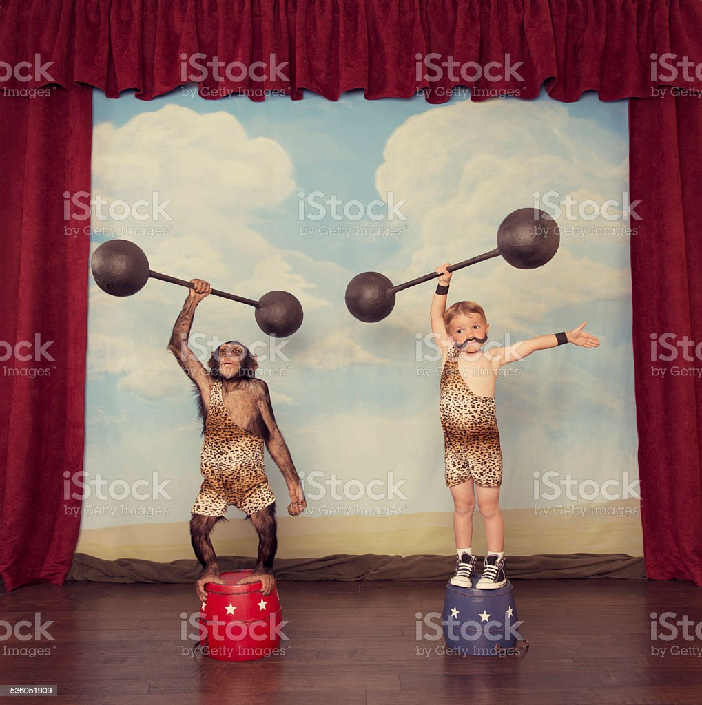 Young Boy and Chimp Friend in the Circus stock photo