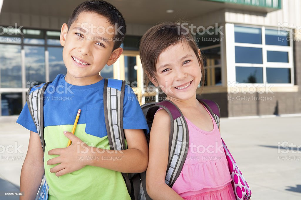 Young boy and girl at school royalty-free stock photo