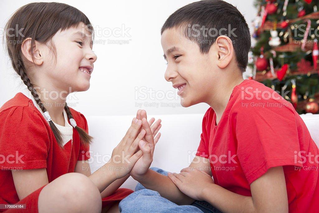 Young boy and girl bonding during Christmas break stock photo