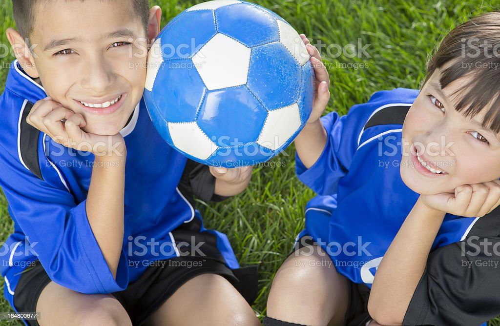 Young boy and girl both holding the soccer ball royalty-free stock photo