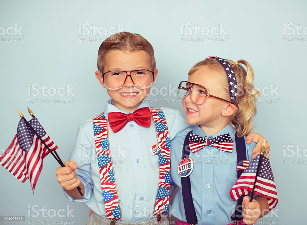 Young Boy and Girl Couple with American Flags stock photo