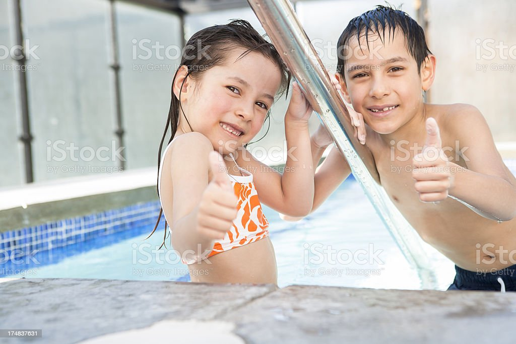 Young boy and girl giving thumbs in the hot tub royalty-free stock photo