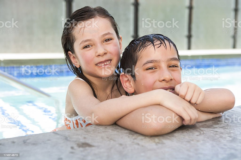 Young boy and girl playing in the hot tub royalty-free stock photo