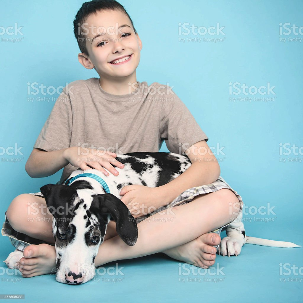 Young Boy and His Puppy Dog stock photo