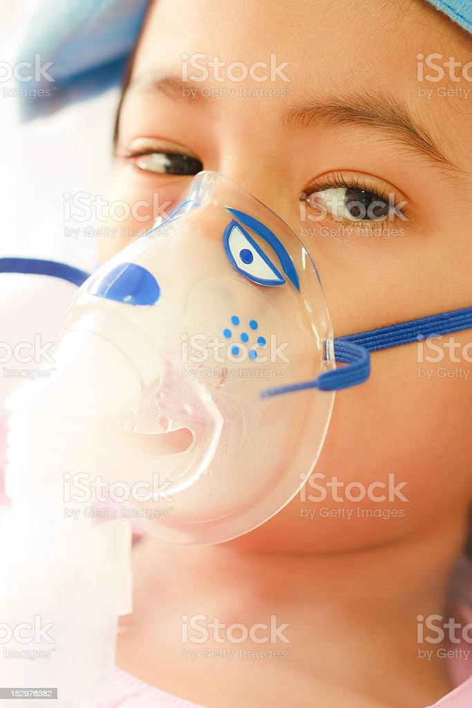 Young boy and hospital instrument on his face royalty-free stock photo