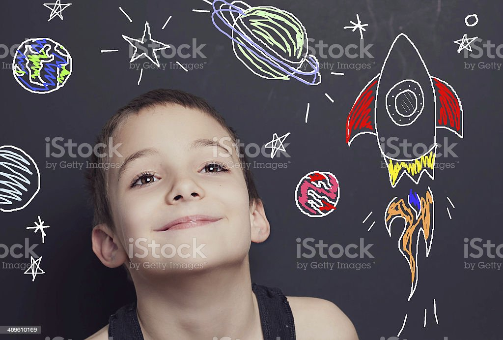 Young Boy and Imaginary Outer Space stock photo