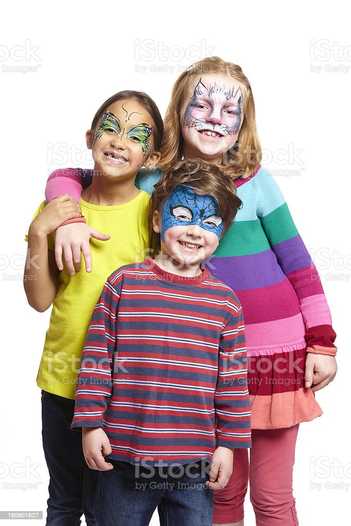 Young boy and two girls with face painting stock photo