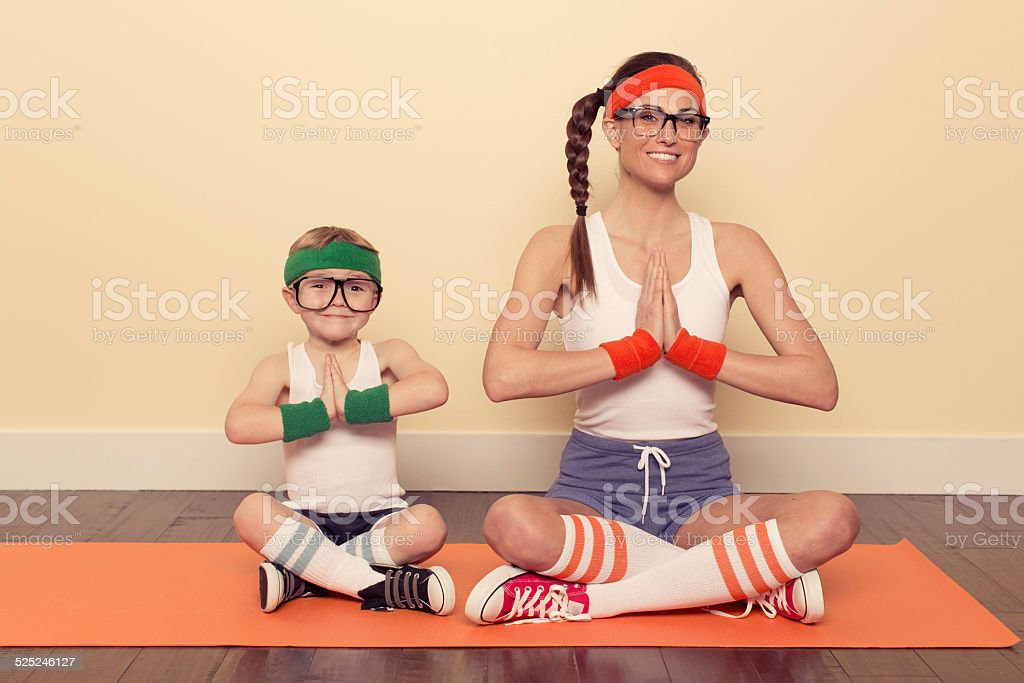 Young Boy and Woman in Retro Workout Clothes stock photo