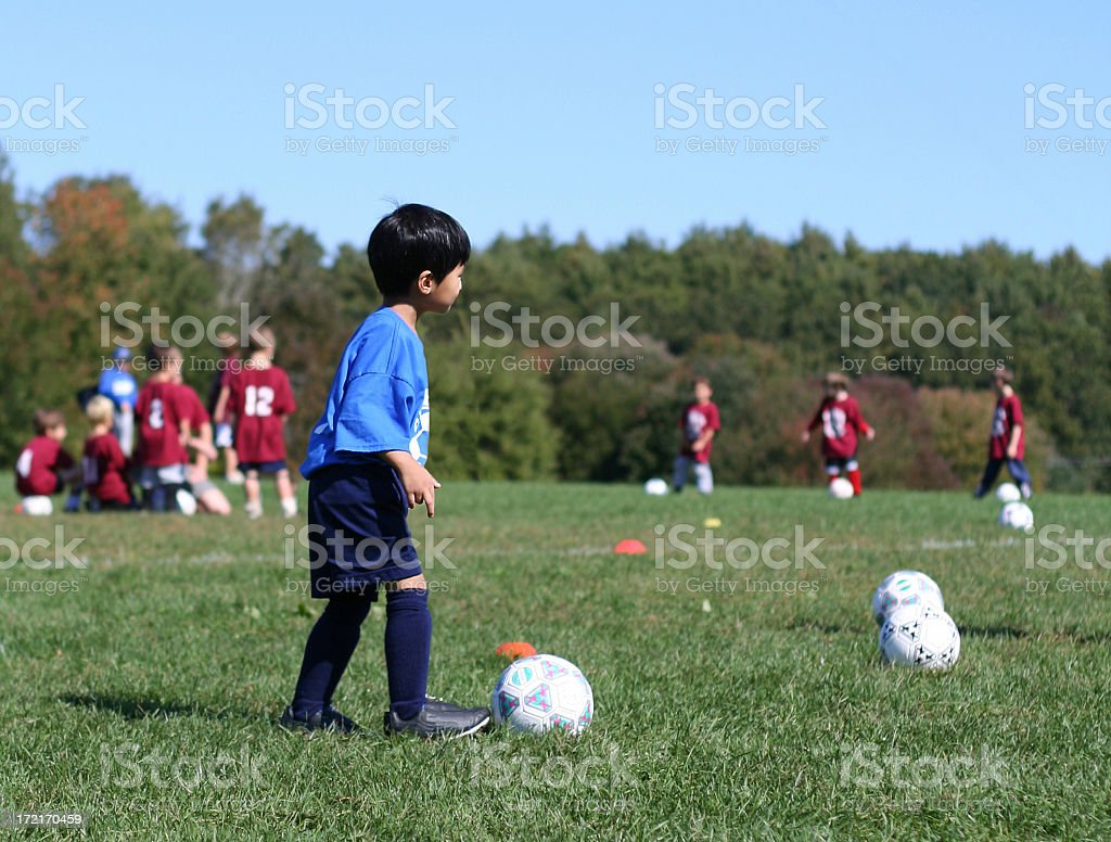 Young boy at soccer practice royalty-free stock photo