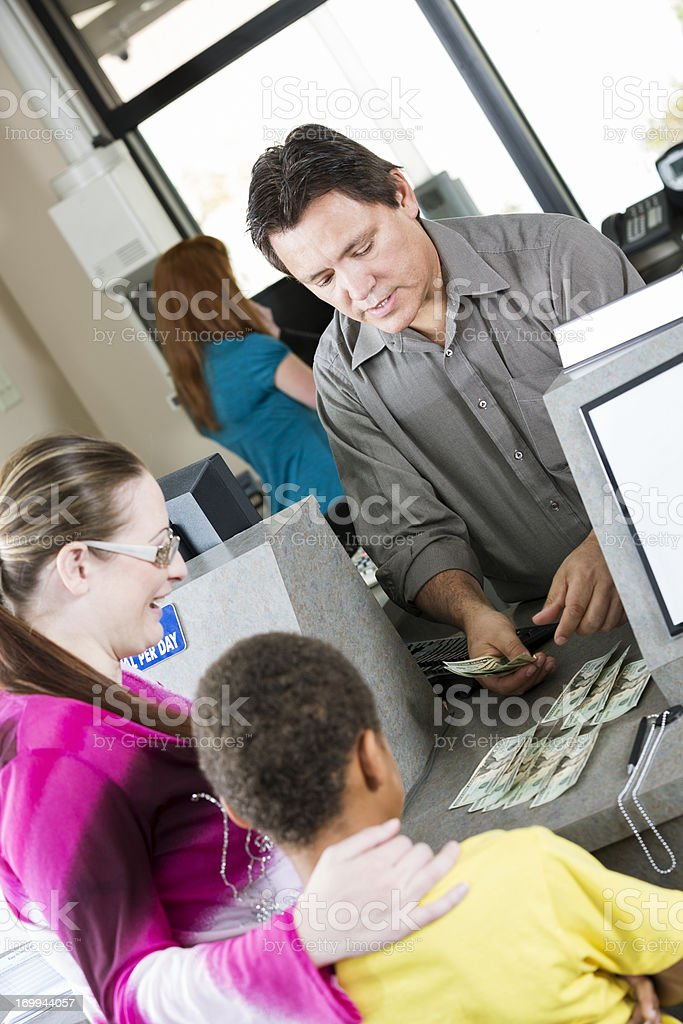 Young boy at the bank with his mother royalty-free stock photo