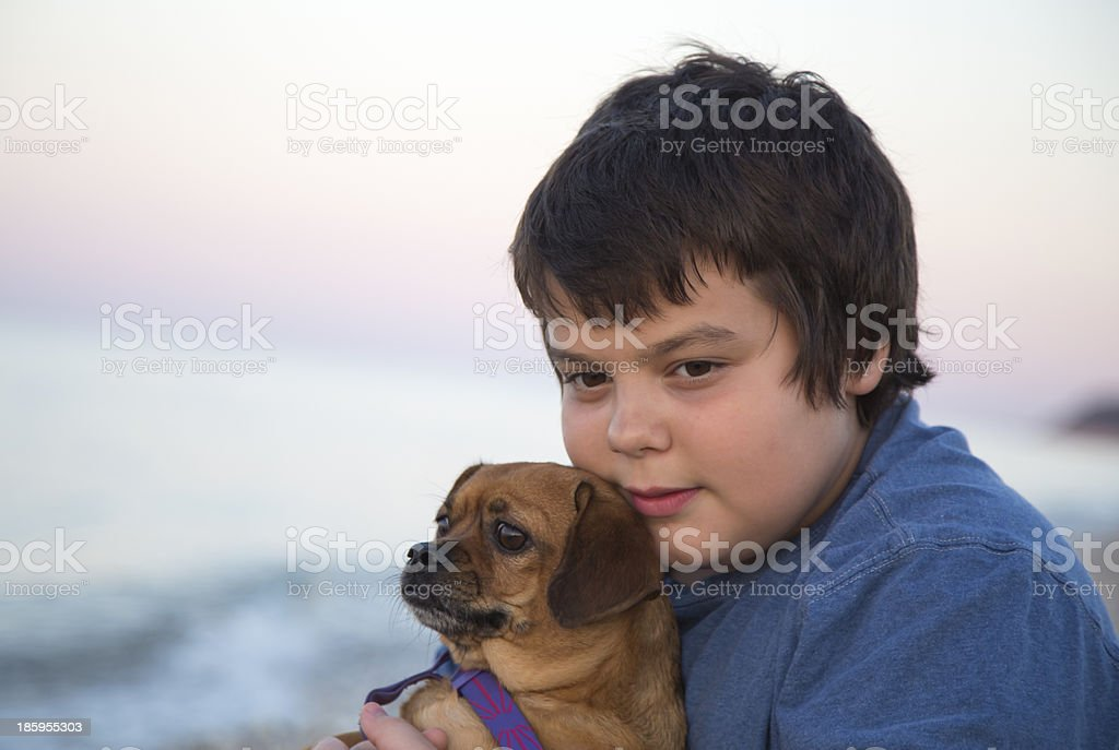 Young boy at the beach with his dog. royalty-free stock photo