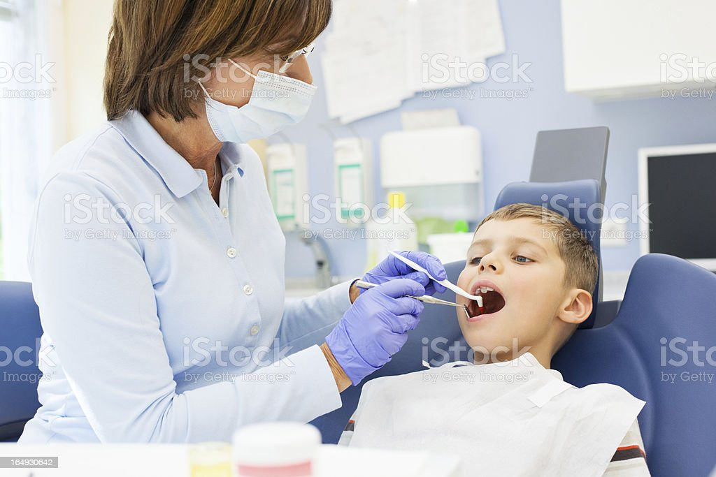 Young boy at the dentist stock photo