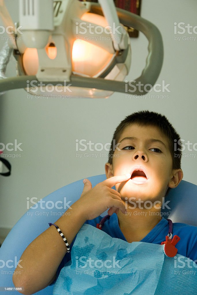 Young boy at the dentist 's chair stock photo