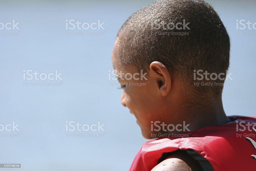 Young boy at the lake royalty-free stock photo