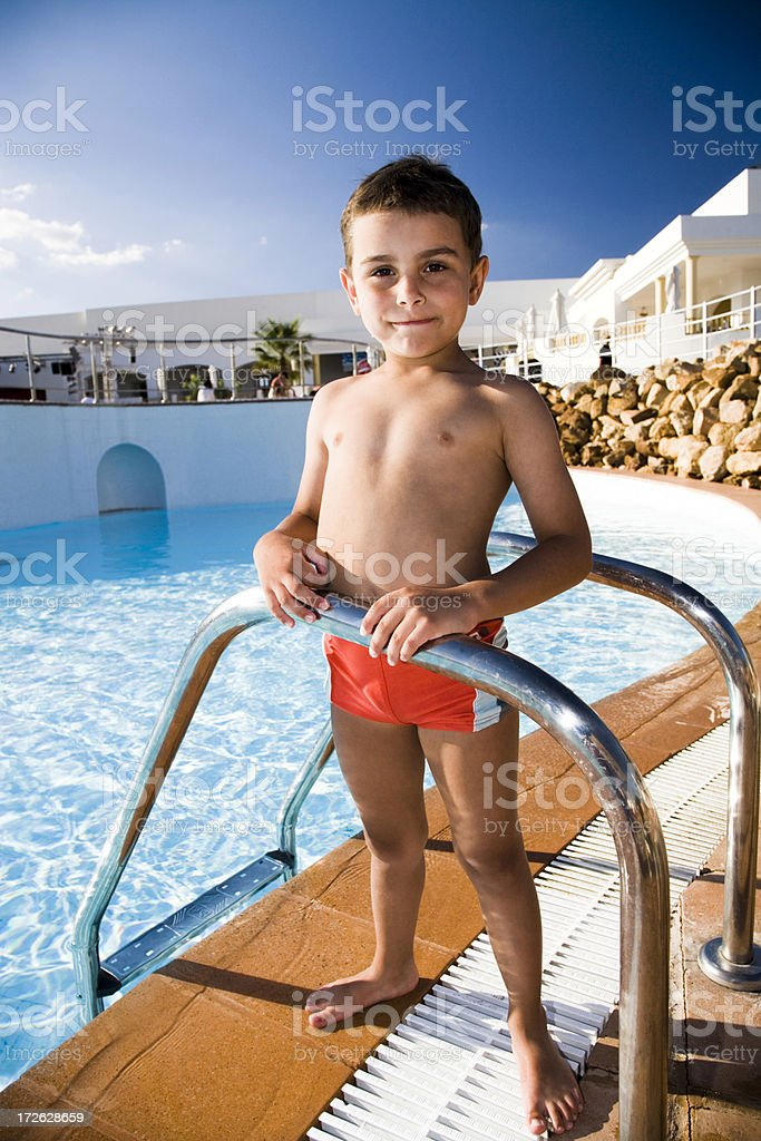 young boy at the swimming pool royalty-free stock photo