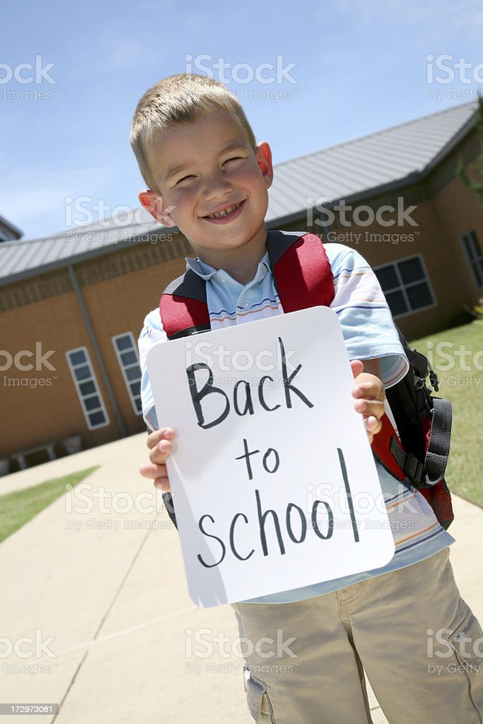 Young boy back at school royalty-free stock photo