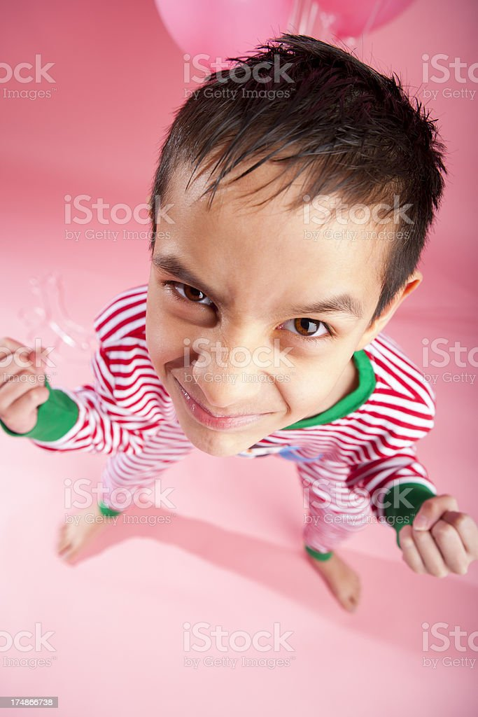 Young boy being silly royalty-free stock photo