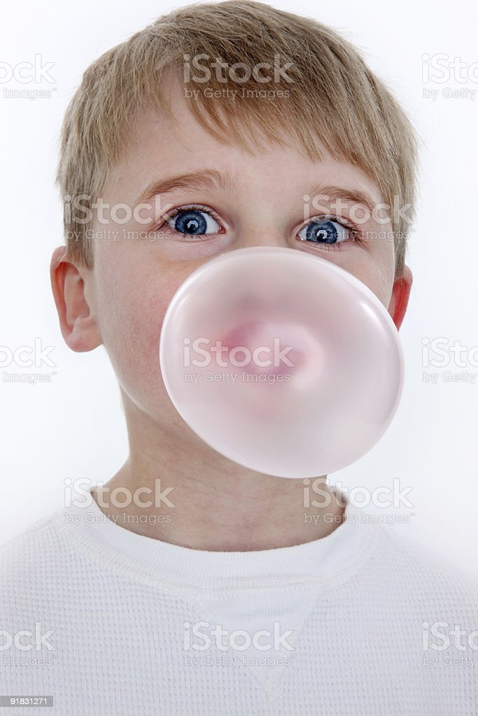 Young boy blowing a bubble royalty-free stock photo