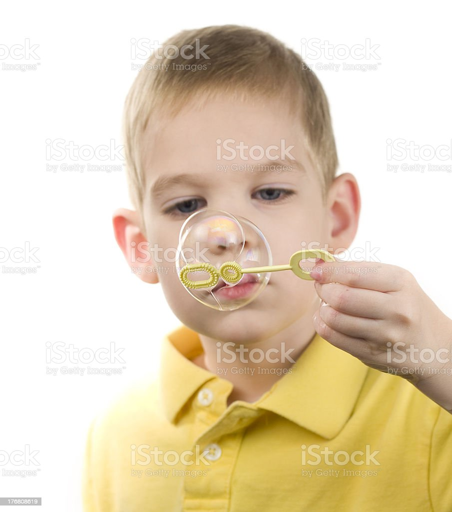 Young Boy Blowing Bubbles stock photo