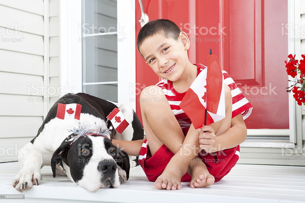 Young boy bonding with his dog on Canada Day stock photo
