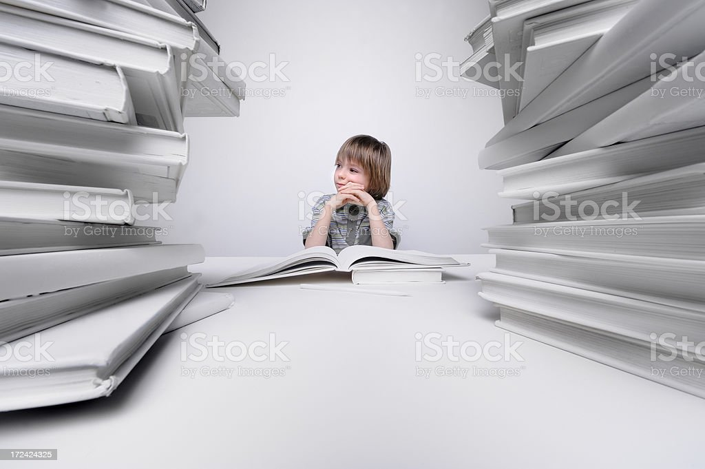 Young boy bored and frustrated with his homework royalty-free stock photo