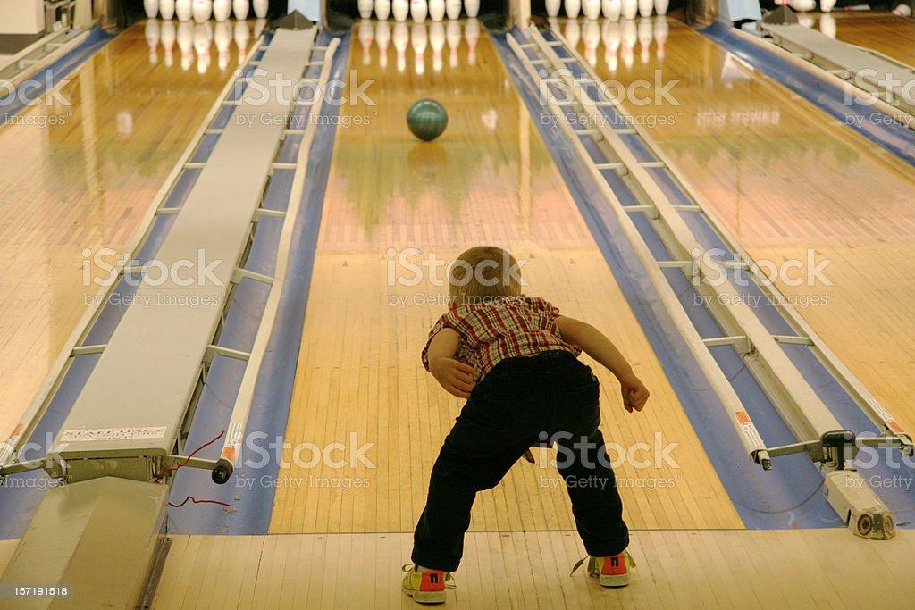 young boy bowling stock photo