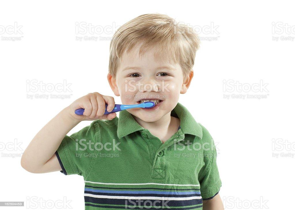 Young Boy Brushing Teeth stock photo