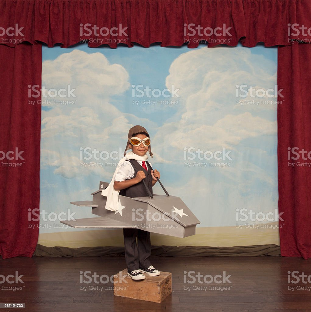 Young Boy Businessman and Pilot in Toy Airplane stock photo