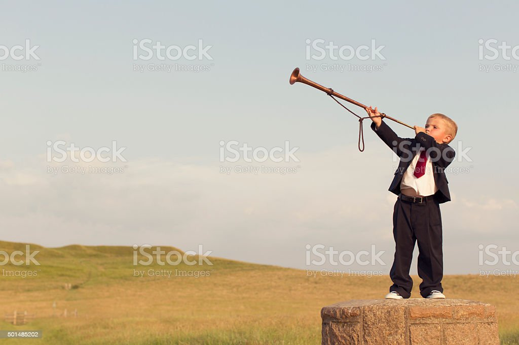 Young Boy Businessman Blows a Trumpet stock photo