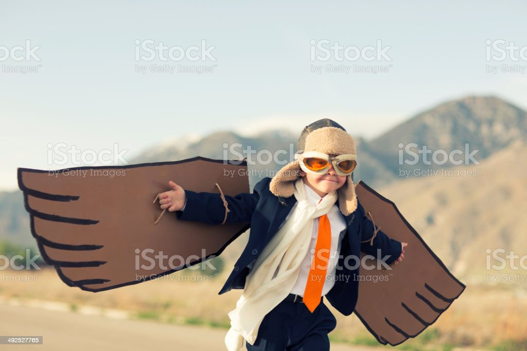 Young Boy Businessman Dressed as Pliot Flies stock photo